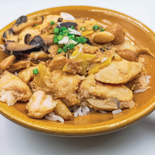 Rice with chicken and mushroom in clay pot