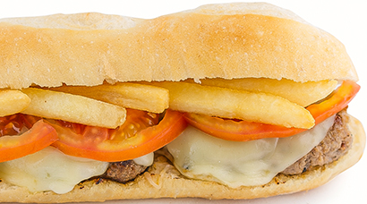 Premium-ground beef burger, french fries (inside sandwich), edam cheese, sliced tomato, ketchup
