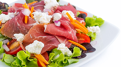 Bed of red & green oak lettuce, smoked Prosciutto di San Daniele DOP, sliced tomato, shredded carrot, diced onion, feta cheese. Includes side of bread and house-made Italian style vinaigrette.